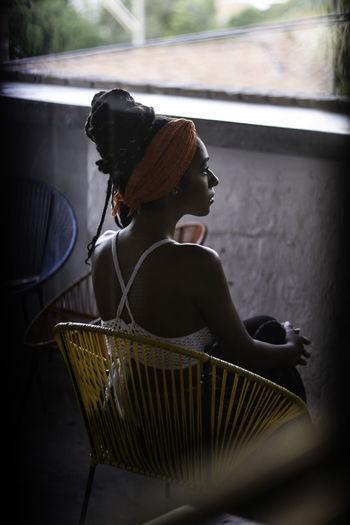 Rear view of woman sitting in basket