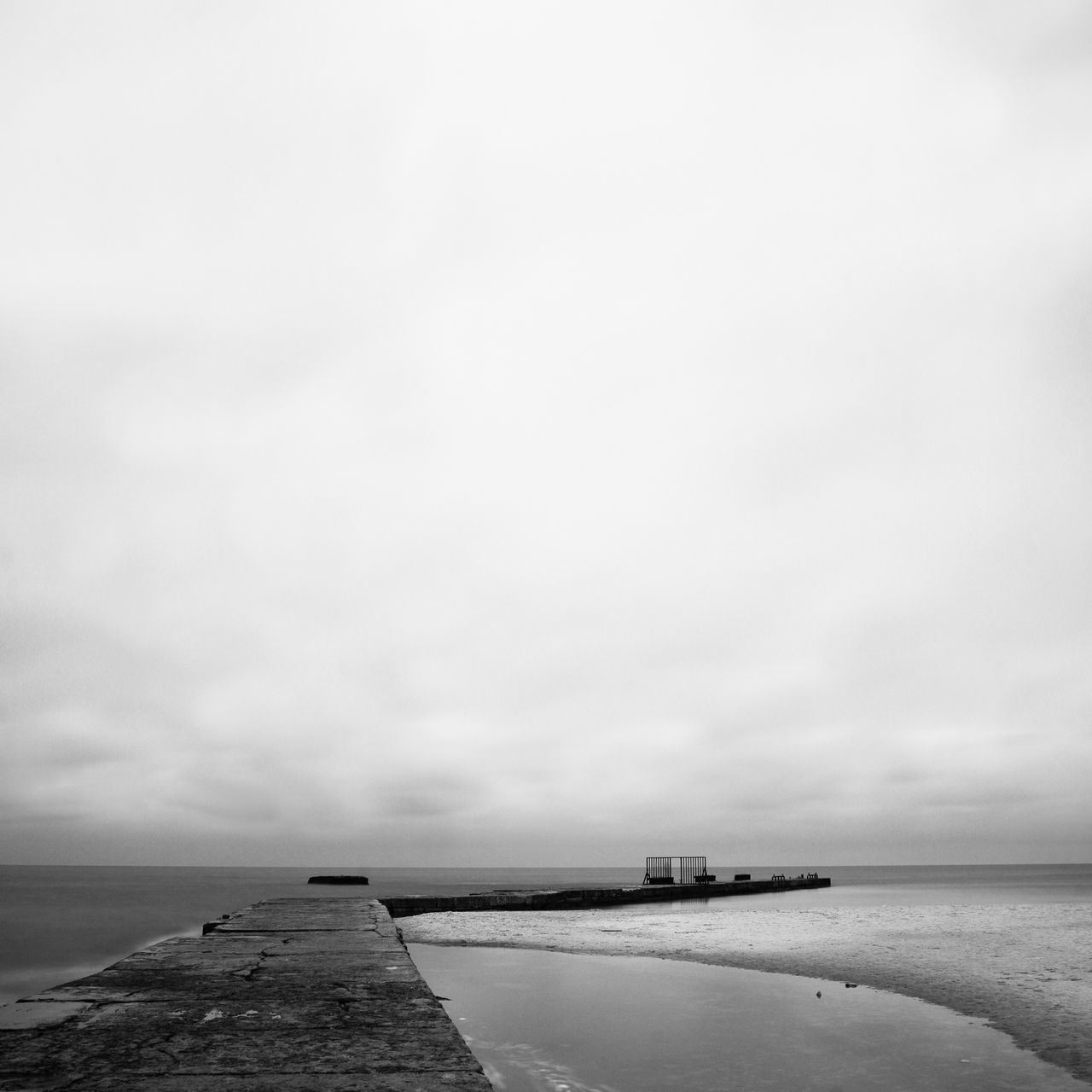 Pier By Sea Against Cloudy Sky