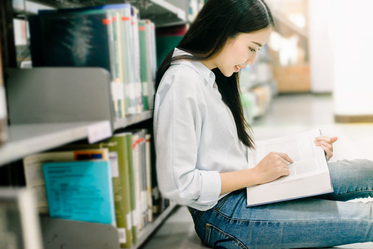 Side view of woman reading book