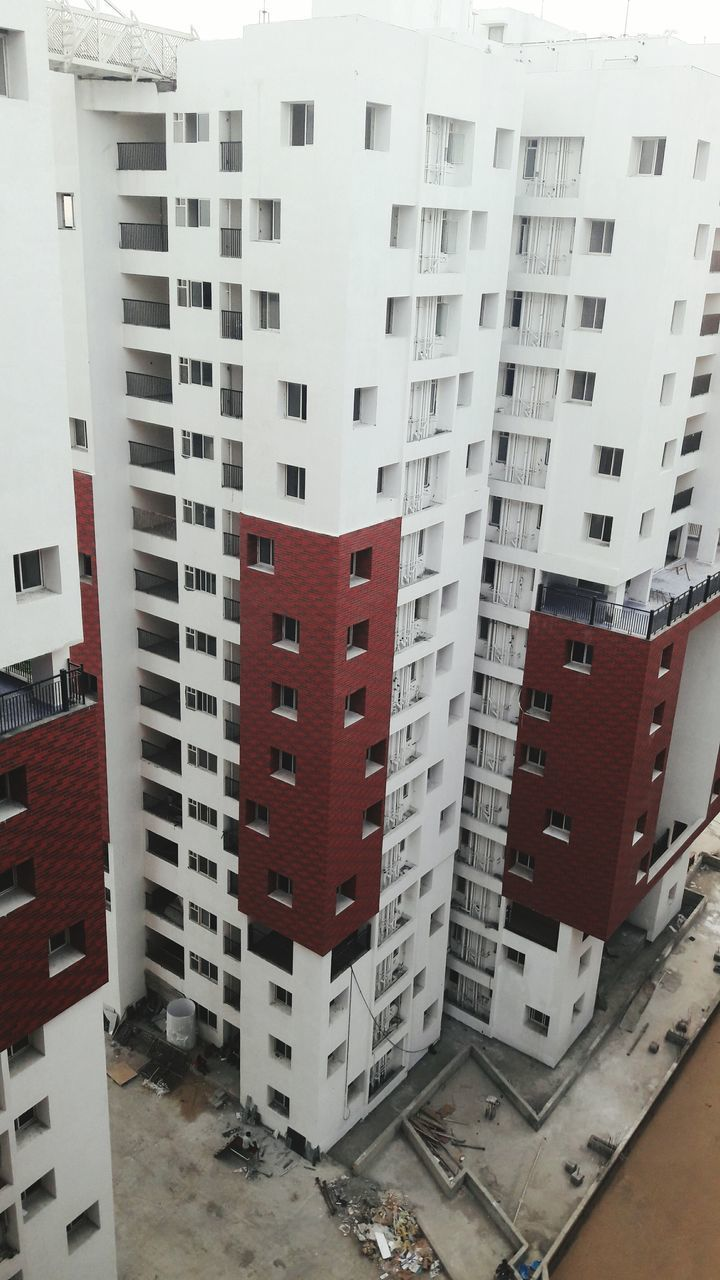 architecture, building exterior, city, built structure, residential building, apartment, window, high angle view, skyscraper, no people, day, cityscape, outdoors