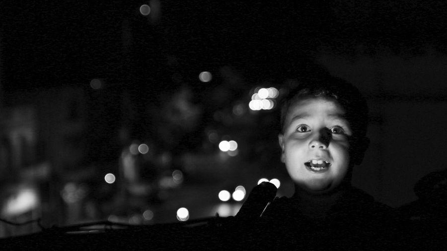 Portrait of girl with illuminated lighting equipment at night