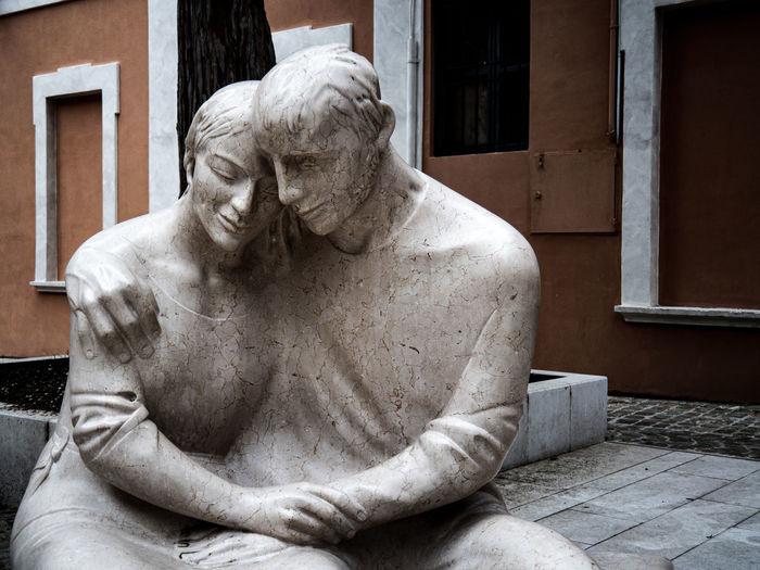 Statue of man sitting on sculpture