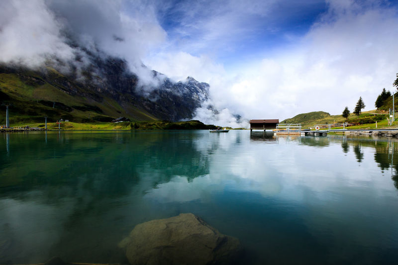 Reflection Reflection Titlis,Switzerland Travel Alps Alps Switzerland Beauty In Nature Cloud - Sky Day Destination Hot Spring Lake Mountain Nature No People Outdoors Reflection Scenics Sky Steam Tranquil Scene Tranquility Travel Destinations Tree Trübsee Water Colour Your Horizn