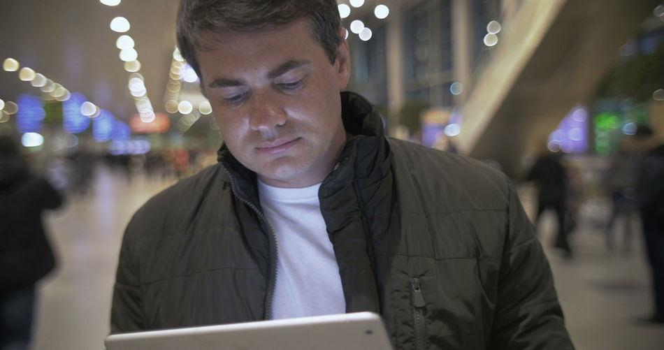 Portrait of man using mobile phone at night