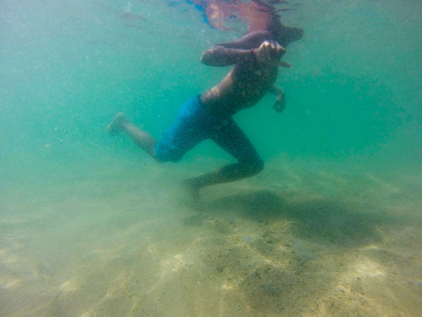 A boy swims near a semi virgin beach. Pichilinguillo Adventure Day Exploration Leisure Activity Lifestyles Men Motion Nature One Person Outdoors Real People Scuba Diver Scuba Diving Sea Swimming UnderSea Underwater Water An Eye For Travel
