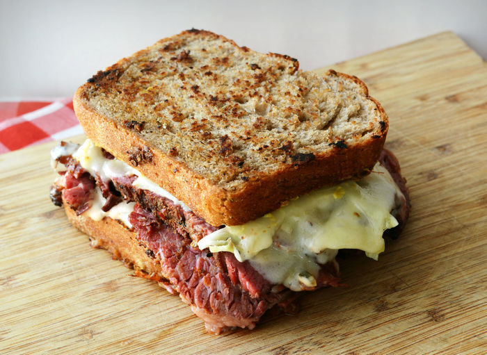 Bread Cheese! Close-up Cutting Board Food Food And Drink Freshness Grilled Reuben Sandwich On Rye Bread Home Made Home Made Bread Homemade Lunch No People Pastrami Pastrami Sandwich Ready-to-eat Rueben Sandwich Rye Bread Sandwich Snack Toasted Toasted Bread
