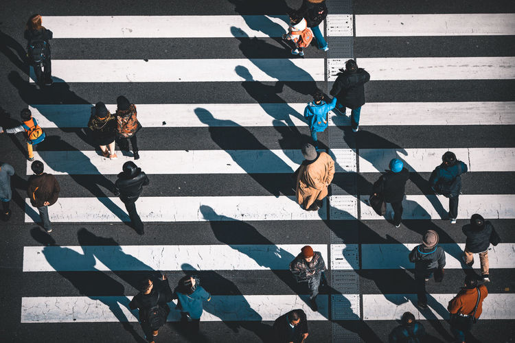A series of 3 crossing photos from Tokyo. Here the shadows and the natural contrast of the crossing took my eye. I wanted to capture everyday life from a different perspective. Japan Light Lines Morning Light Road The Street Photographer - 2018 EyeEm Awards Tokyo Travel WeekOnEyeEm Canon City Crossing Crosswalk Day High Angle View Light And Shadow People Shadows Street Streetphotography Walking Week On Eyeem Zebra Crossing