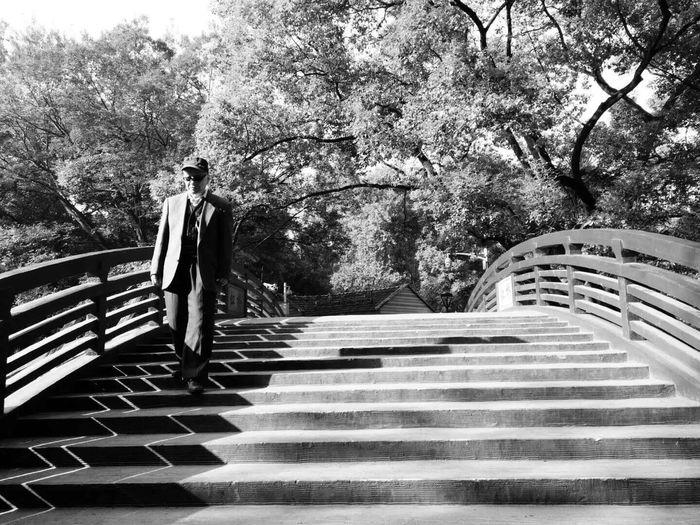 Senior man moving down on steps at park