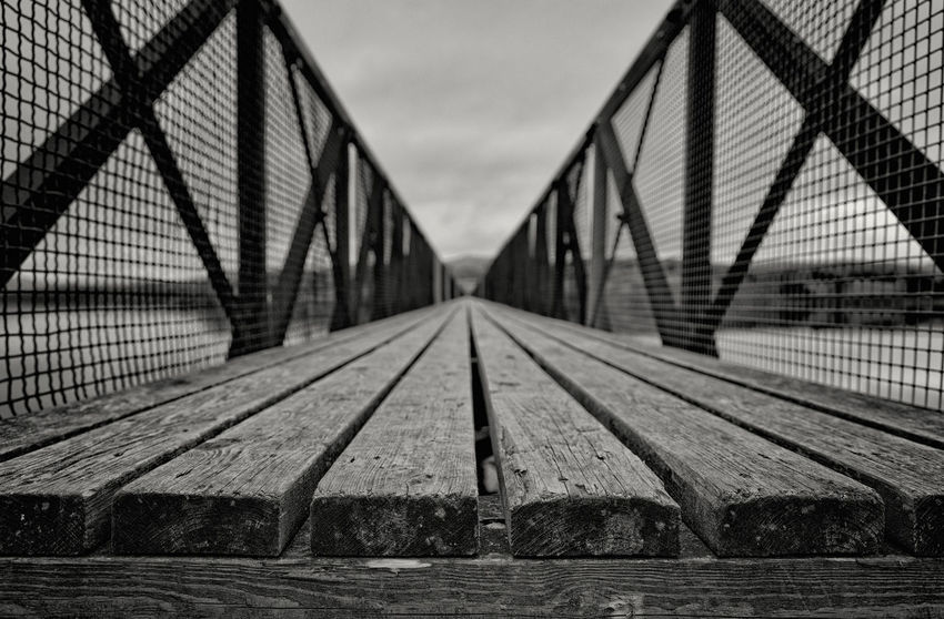 Black & White Bridge - Man Made Structure Connection Day Diminishing Perspective Empty Engineering Footbridge Long Metallic Nature No People Outdoors Sky Surface Level The Way Forward Vanishing Point Weather