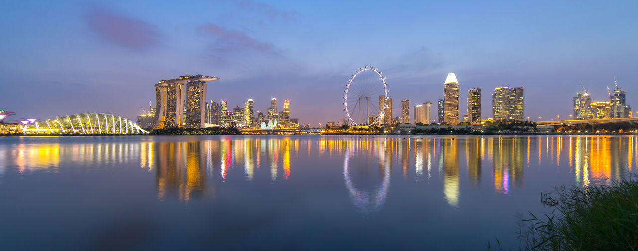 Singapore city reflection at dusk Architecture Building Exterior Built Structure City Cityscape Dusk Flyer Illuminated Marina Bay Marina Bay Sands Merlion Night Reflection Singapore Sky Skyline Skyscraper Sunset Tower Travel Destinations Urban Skyline Water Waterfront