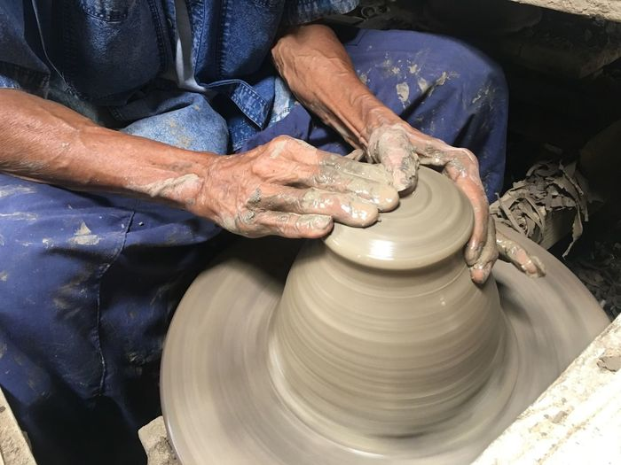 Midsection Of Craftsperson Doing Pottery