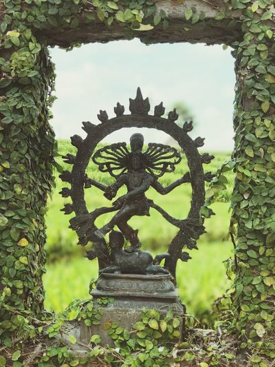 Religion Spirituality Day Outdoors Place Of Worship No People Built Structure Statue Low Angle View Architecture Sculpture Building Exterior Sky Tree Nature Close-up Bali
