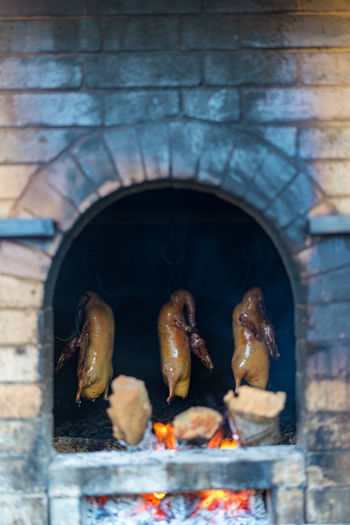 Burning Food Fire Heat - Temperature Flame Food And Drink Fire - Natural Phenomenon Barbecue Meat No People Close-up Preparation  Day Freshness Outdoors Built Structure Metal Grilled Wall - Building Feature Wood - Material