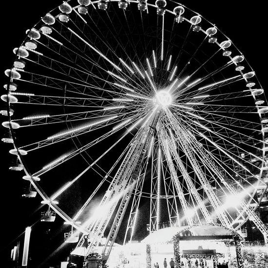 Christmas market in Essen, Germany Christmasmarket Advent Stadtessen Ruhrgebiet Blackandwhite Blackandwhitephotography Ferris Wheel City Lights City Ferriswheel Ferriswheelinthecity🎡🎢 Ferris Wheel At Night Illuminated Illumination