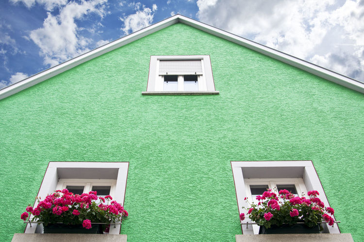 Green Square Architecture Building Building Exterior Built Structure Cloud - Sky Day Flower Flowering Plant Green Color House Low Angle View Nature No People Outdoors Pink Color Plant Potted Plant Residential District Sky Stuffy Window Window Box
