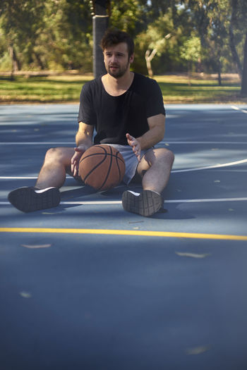Man Playing With Ball At Park