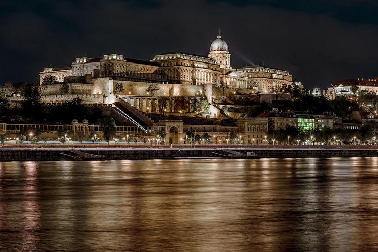 Illuminated royal palace of buda against sky at night