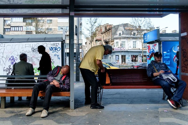 The bus stop X-Pro1 Fujifilm X-Pro1 Street Hunters Streethunters Street Photography Streetphotography Sitting Men Seat Adult Day People Lifestyles Street The Street Photographer - 2018 EyeEm Awards