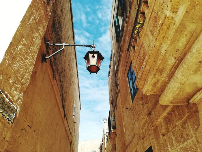 Among the alleys of Mdina (Malta) Island Europe Foreshortening Travel Holidays Hystorical Centre Street Lamp Building Old Alley Mdina Malta Light Hanging City Sky Architecture Close-up