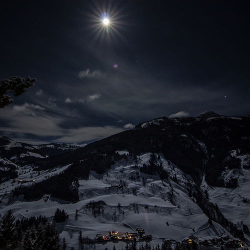 Full moon over the Grossarl valley Grossarltal Astronomy Beauty In Nature Cloud - Sky Cold Temperature Landscape Moon Mountain Nature Night No People Outdoors Scenics Sky Snow Tranquility Tree Winter