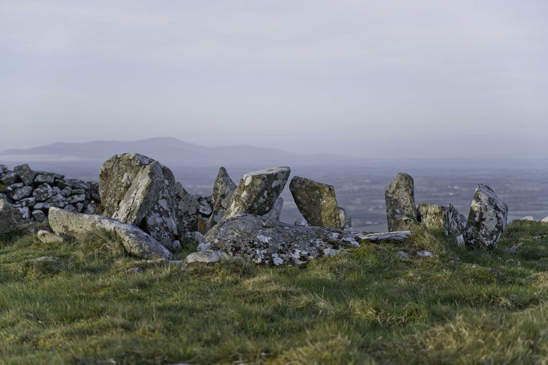 Panoramic view of rocks on field against sky