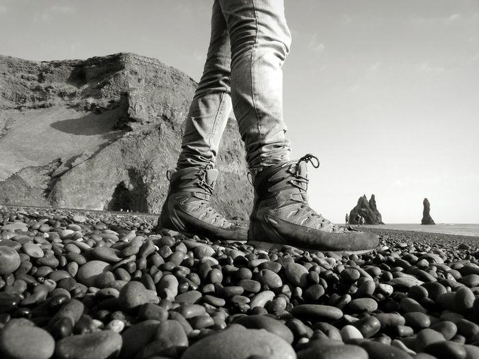 Sky Beach Nature One Person Stones Jeans Stony Beach Iceland Walking Black & White Mountain Sea Rocks Trekking Shoes Miles Away Stones Beach Pebble Beach Iceland_collection Iceland Trip Be. Ready.