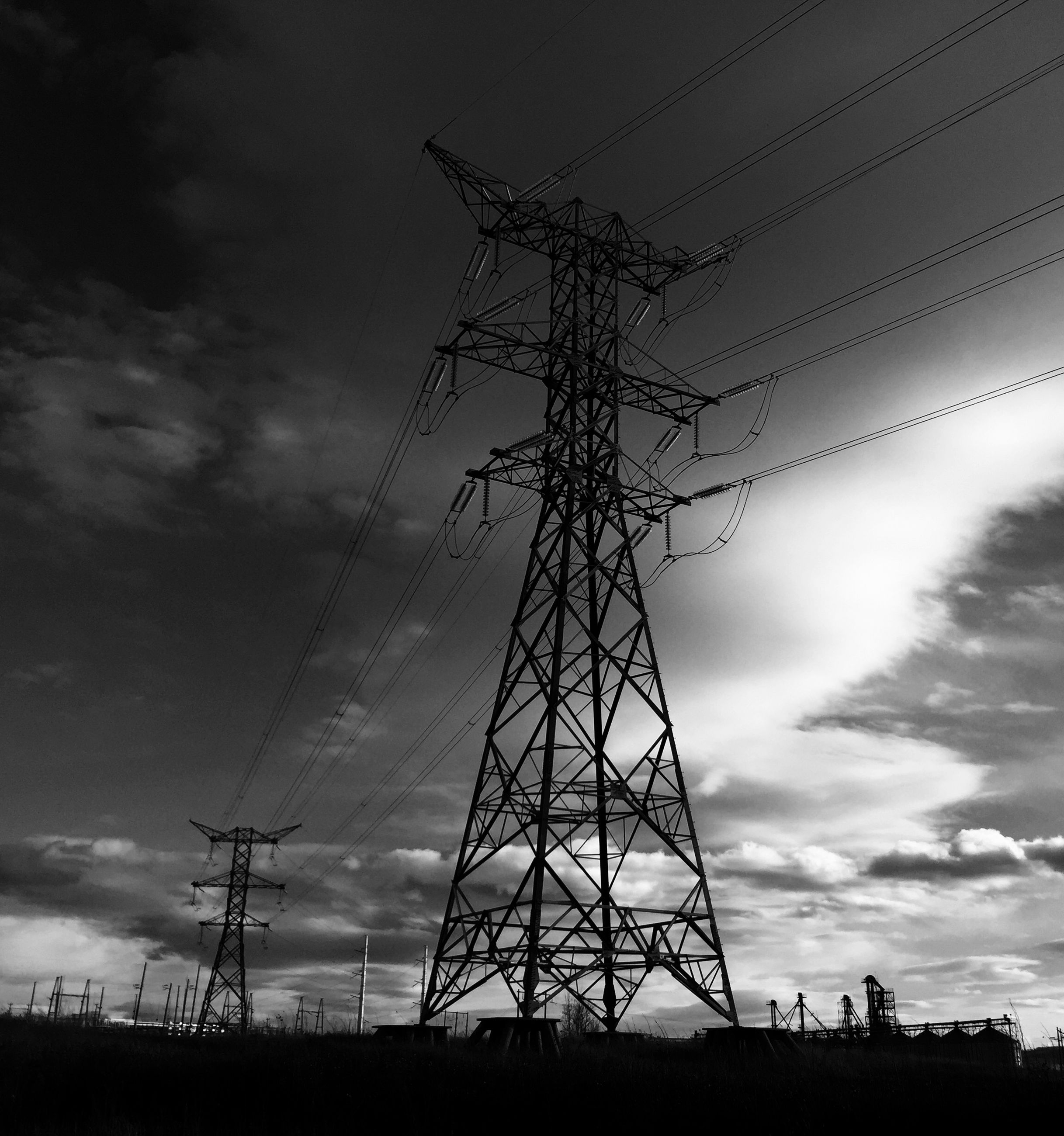 electricity pylon, low angle view, power line, silhouette, power supply, sky, connection, electricity, fuel and power generation, technology, cable, cloud - sky, cloudy, sunset, cloud, dusk, power cable, outdoors, nature, no people