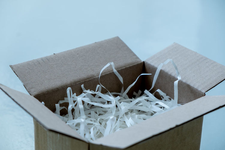 Close-up of white paper in box on table