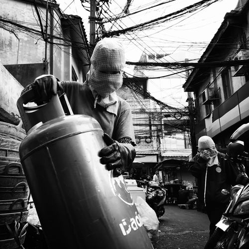 Sampeng Real People Built Structure Outdoors Mature Adult Day Architecture One Person Lifestyles Men Occupation Drum - Container City Warm Clothing Hardhat  Adult People Bangkok EyeEm Best Shots - Black + White The Street Photographer - 2017 EyeEm Awards EyeEm Best Shots