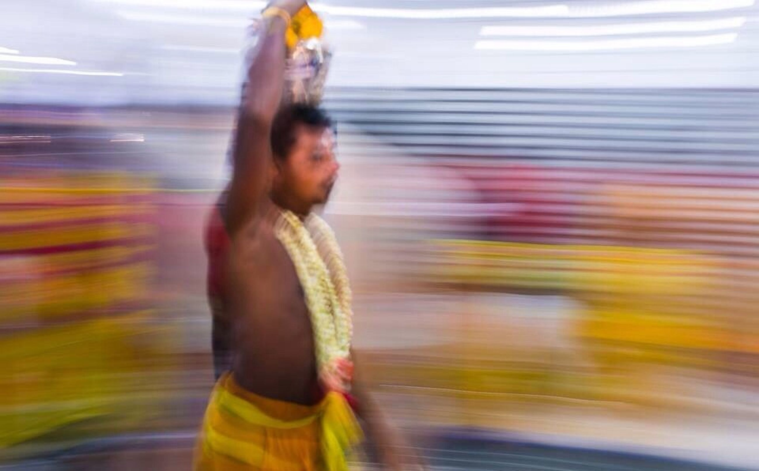 blurred motion, transportation, motion, lifestyles, speed, on the move, car, leisure activity, casual clothing, mode of transport, travel, rear view, side view, road, standing, street, three quarter length, glass - material