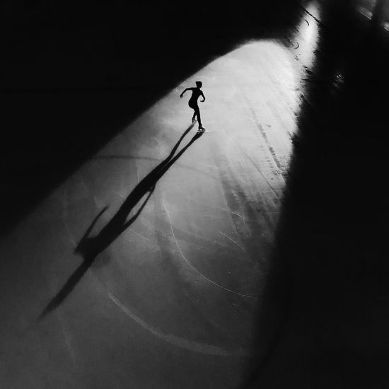 High angle view of silhouette man standing on street