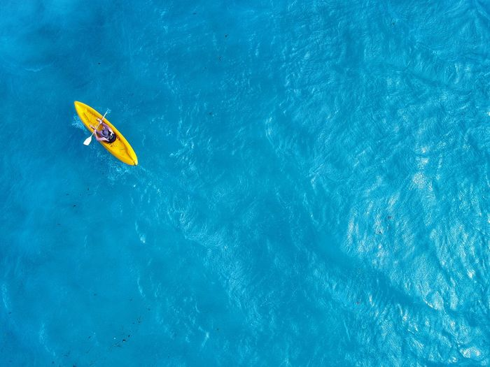 Row your boat. 2018 was all about supporting my BF on his attempt of rowing. I am proud of you and mean while I enjoy photographing your process. Dronephotography Drone  DJI X Eyeem Kayak Rowing Ocean Sports Water Blue Nature Trip Vacations Sport Holiday Sea Summer Outdoors Aquatic Sport Leisure Activity High Angle View Turquoise Colored People Travel The Great Outdoors - 2018 EyeEm Awards The Great Outdoors - 2018 EyeEm Awards 2018 In One Photograph It's About The Journey 17.62°