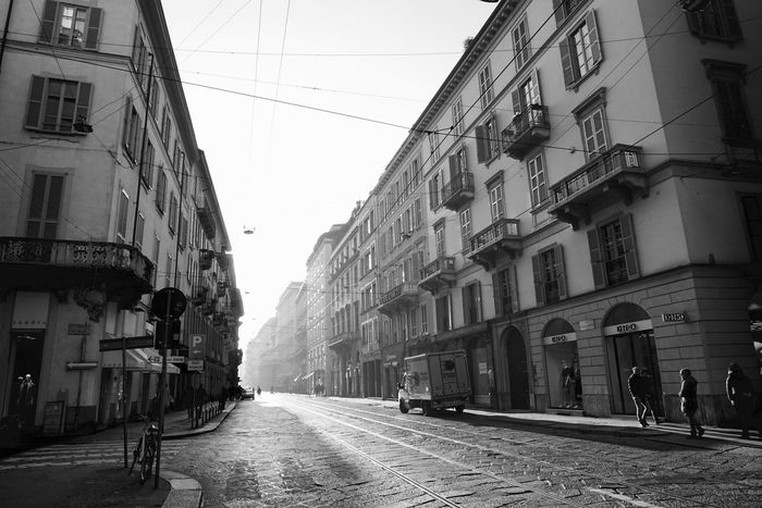 New light, new day, new hope Architecture Blackandwhite Building Exterior City Citylife Day Light Light And Shadow Milano Monochrome Morning Morning Light People Perspective Residential Building Silhouette Street Street Life Streetphotography Sunlight The City Light EyeEmNewHere