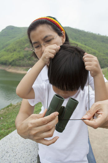 Kaeng Krachan Dam Mother And Son Love Binoculars Cute Sky Togetherness Friendship Vacations Asianboy Asianwoman EyeEm Selects Archival Child Two People Adult Girls Holding Day Nature People Outdoors Women Water
