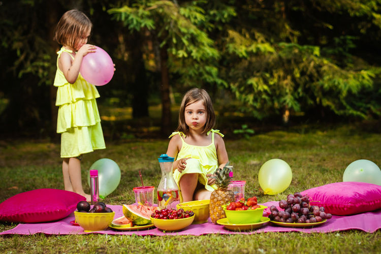 Picnic Girl Child Childhood Kid Forest Summer Sister Sisters Twins Girls Food Women Food And Drink Females Family Offspring Easter Togetherness Easter Egg Celebration Innocence Standing Casual Clothing Full Length Day Sibling Emotion