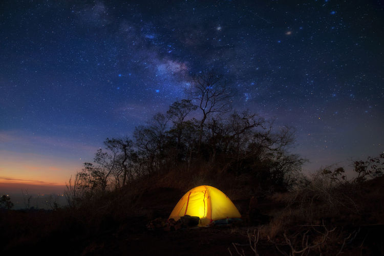 The Milky Way on Mountain and Yellow Camping Tent in Thailand Sky Night Star - Space Space Tent Camping Astronomy Tree Scenics - Nature Nature Beauty In Nature Illuminated No People Plant Galaxy Land Tranquility Field Star Tranquil Scene Outdoors Milky Way