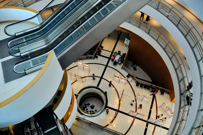 High angle view of people on escalator in building