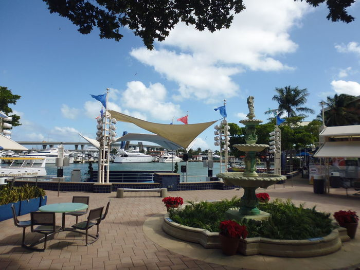 Bayside Marketplace - Miami, FL Bayside Marketplace Bayside Miami Fountain Geometric Shapes Sky And Clouds Susan A. Case Sabir Tropics Unretouched Photography Awning Chair Clean Cloud - Sky Day No People Outdoor Cafe Outdoors Round Shape Sky Table Tropical Tropical Climate