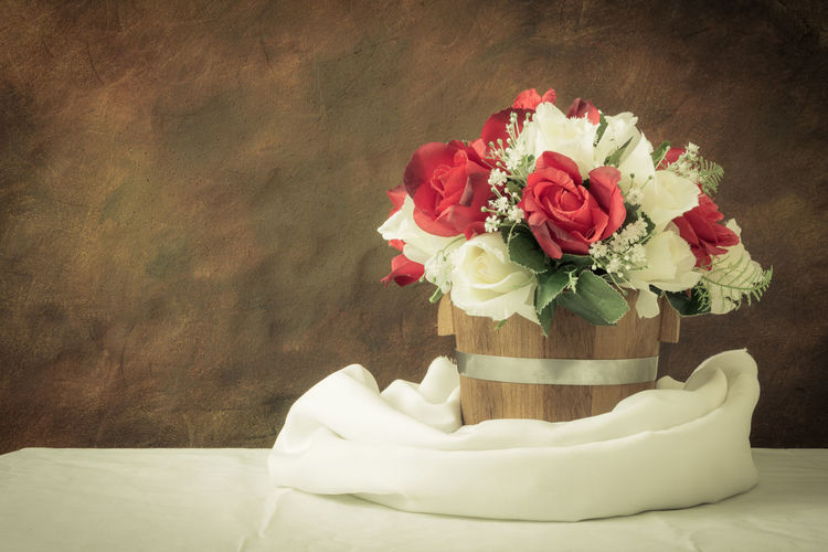 Close-up of flowers in vase on table