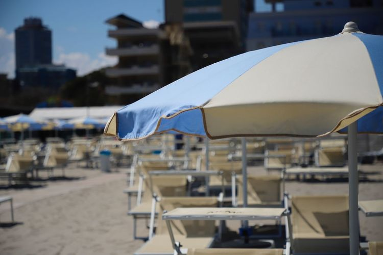 Parasol Architecture Nature Day No People Outdoors Seat Sunshade In A Row Sun Bed Sunbeds Sun Beds Beachphotography Beach Italy Milano Marittima Adriatic Sea Adria Adriatic Travel Travel Destinations Summer Summertime Sunshine Holiday Vacations Destinations Traveling Blue