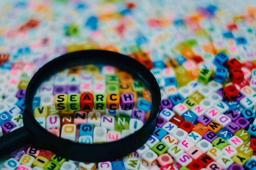 Beads Business Content Letters Social Word Alphabet Concept Engine Find Large Group Of Objects Magnifying Glass Multi Colored Optimization Search Seo Strategy Text