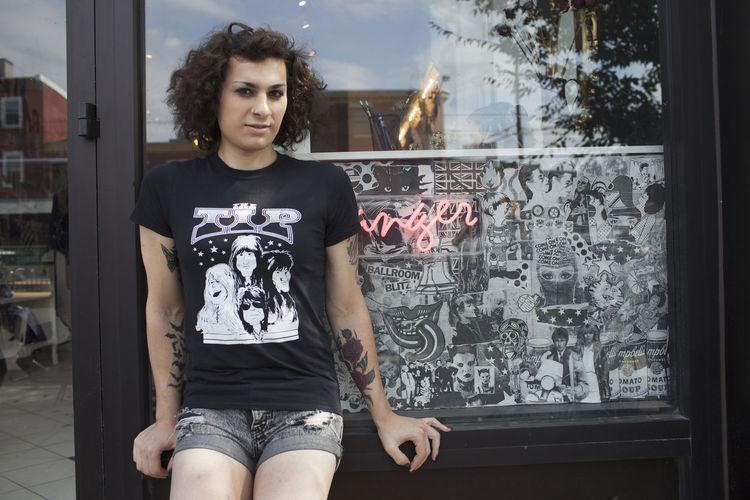 Portrait of senior woman standing by window
