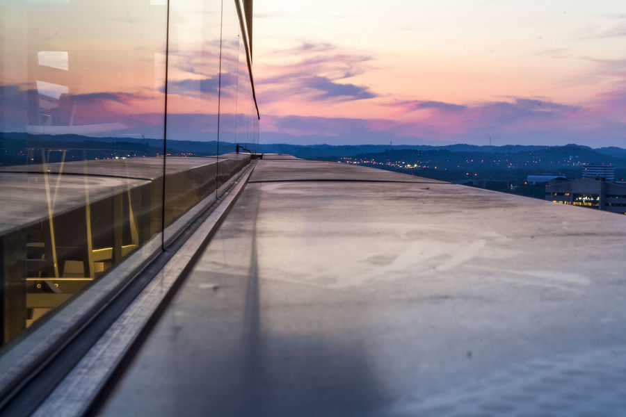 City Dusk Edge Edge Of The World Industrial Nashville Precarious Reflection Sunset In The City  Building Exterior City Lights City Sunset City View  Cityscape Diminishing Perspective Dusk Dusk In The City Glass - Material Ledge No People On The Edge Over The Ledge Reflection Sunset Reflection vanishing point Window