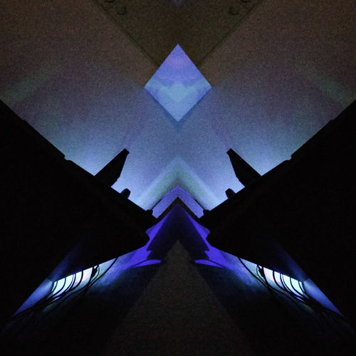 mirror effect Neon Mirroreffect Directly Below Triangle Shape Architecture Night Built Structure No People Symmetry