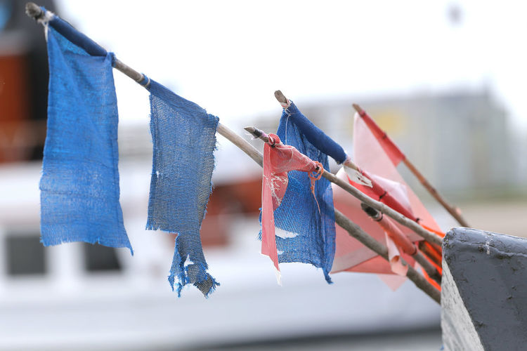 Low angle view of flags hanging on clothesline