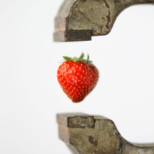 Close-up of strawberry against white background