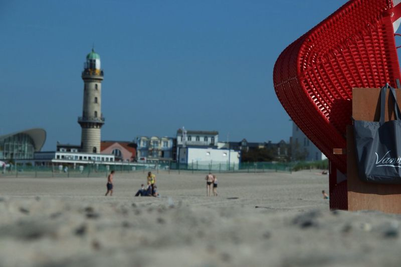 Hooded Beach Chair With People In Background