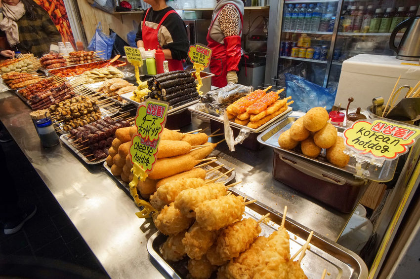 Korean street food in Myeongdong, March 2018,South Korea, Seoul 2018 Hotdogs MyeongDong Winter Cheese Choice Cold Temperature Food Food And Drink For Sale Freshness March Market People Real People Retail  Street Fashion Variation