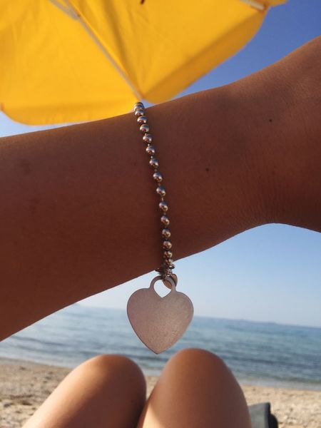Human Body Part One Person Body Part Lifestyles Real People Human Leg Leisure Activity Nature Close-up Personal Perspective Day Women Human Hand Limb Land Unrecognizable Person Beach Low Section Jewelry Hand