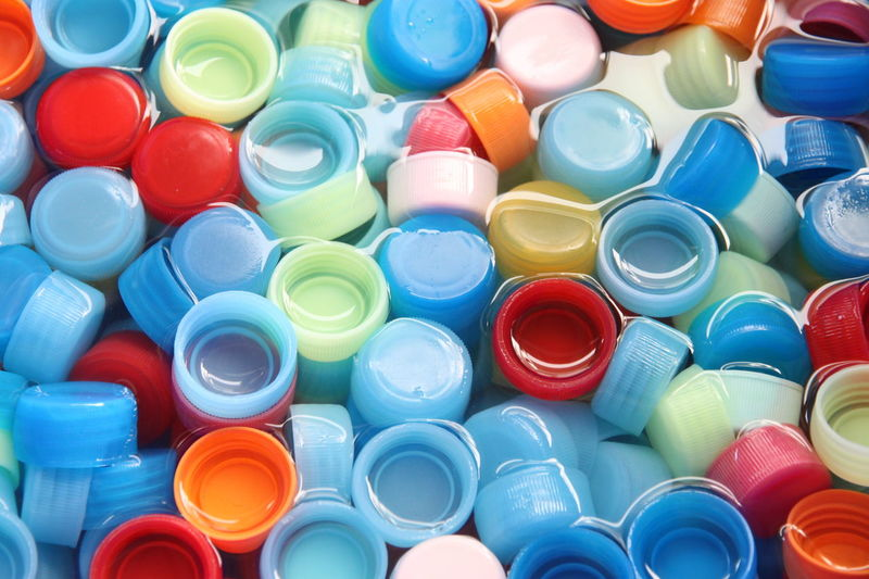 many colors bottle caps with caps in four colors of background. Bottle Cap Abundance Backgrounds Bottle Bottle Cap Bottle Caps Bottle Caps Art Bottles Choice Circle Close-up Collection Directly Above Full Frame Geometric Shape High Angle View Indoors  Large Group Of Objects Multi Colored No People Plastic Shape Stack Still Life Variation